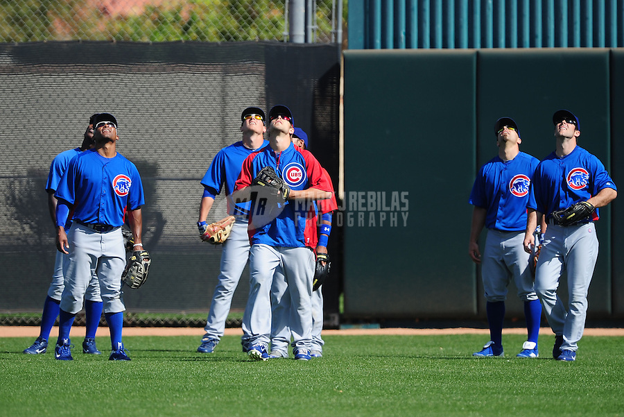Feb. 29, 2012; Mesa, AZ, USA; Chicago Cubs outfielders look up during pop fly drills during spring training workouts at Fitch Park.  Mandatory Credit: Mark J. Rebilas-.