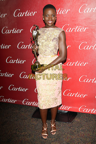 PALM SPRINGS, CA - JANUARY 4: Lupita Nyong'o backstage at the 25th Annual Palm Springs International Film Festival Film Awards Gala on January 4, 2014 at Palm Springs Convention Center, California. <br /> CAP/MPI/RTNUPA<br /> &copy;RTNUPA/MPI/Capital Pictures