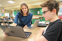 From left, teacher Michelle Ambrosini works with Liam Donnelly, 12, in her seventh grade English Language Arts class Tuesday, November 07, 2017 at Holing Middle School in Buckingham, Pennsylvania. Ambrosini has been named Teacher of the Year by the Veterans of Foreign Wars Chapter 175 of Doylestown. (Photo by William Thomas Cain)