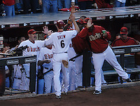 Oct 11, 2007; Phoenix, AZ, USA; Arizona Diamondbacks shortstop (6) Stephen Drew is congratulated after scoring off an RBI double by left fielder (22) Eric Byrnes in the first inning against the Colorado Rockies during game 1 of the 2007 National League Championship Series at Chase Field. Mandatory Credit: Mark J. Rebilas-US PRESSWIRE