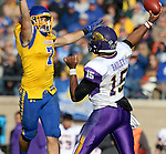BROOKINGS, SD - OCTOBER 24:  Jesse Bobbit #7 from South Dakota State tries to disrupt the pass by Aaron Bailey #15 from University of Northern Iowa in the third quarter of their game Saturday afternoon at Coughlin Alumni Stadium in Brookings. (Photo by Dave Eggen/Inertia)