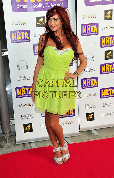 Amy Childs.The National Reality TV Awards at O2 Arena, London, England. .July 6th, 2011.full length green neon fluorescent dress hand on hip silver shoes peep toe strapless.CAP/CJ.©Chris Joseph/Capital Pictures.