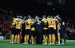 Cambridge players and staff have a group hug at the end of the match - FA Cup Fourth Round replay - Manchester Utd  vs Cambridge Utd - Old Trafford Stadium  - Manchester - England - 03rd February 2015 - Picture Simon Bellis/Sportimage