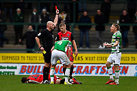 Referee Charles Breakspear   gives a second yellow and a red card to Craig Alcock of Yeovil Town during Yeovil Town vs Grimsby Town, Sky Bet EFL League 2 Football at Huish Park on 9th February 2019