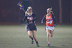 Santa Barbara, CA 02/18/12 - Catherine La Plant (Chapman #12) and Brittini Peck (Florida #15) in action during the Chapman - Florida matchup at the 2012 Santa Barbara Shootout.  Florida defeated Chapman 12-11.