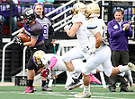 SIOUX FALLS, SD - OCTOBER 18: Nephi Garcia #3 from the University of Sioux Falls tries to gain a few extra yards past Andrew McReynolds #2 and Jared Twedt #21 from Southwest Minnesota State in the first half of their game Saturday afternoon at Bob Young Field in Sioux Falls. (Photo by Dave Eggen/Inertia)