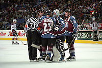 Goaltender Patrick Roy #33, right winger Milan Hejduk #23, defenseman Adam Foote #52 and an unidentified player (back) of the Colorado Avalanche talk with referee Bill McCreary #7 during a regular season game at HSBC Arena on December 23, 1999 in Buffalo, New York.  Buffalo defeated Colorado 2-1.  (Mike Janes/Four Seam Images)