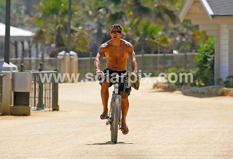 **ALL ROUND EXCLUSIVE PICTURES FROM SOLARPIX.COM**.**WORLDWIDE SYNDICATION RIGHTS**.Pics show Manchester Utd veteran, Ryan Giggs, on holiday with his wife, Stacey (Cooke) in Marbella. The couple hired mountain bikes and took a ride along the beach front while their children were playing in the hotel crèche. Ryan has been leaving Stacey and the children round the pool of their swanky hotel and nipping off back to their room to watch World Cup matches..This pic:   Ryan Giggs and Stacey.JOB REF:    11545    AB1       DATE:   25.06.10.**MUST CREDIT SOLARPIX.COM OR DOUBLE FEE WILL BE CHARGED**.**MUST AGREE FEE BEFORE ONLINE USAGE**.**CALL US ON: +34 952 811 768 or LOW RATE FROM UK 0844 617 7637**