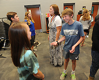 NWA Democrat-Gazette/ANDY SHUPE<br /> Brooks Farrah (right), speaks Wednesday, Sept. 2, 2015, with Elizabeth Wright (left), both 14-year-old ninth-graders at Fayetteville High School, as teacher Leann Girshner (center) directs while taking part in an exercise in speaking to another person during their advisory period at Fayetteville High School. The students are in the ninth-grade White B small learning community team and spend the period learning about education opportunities and building related skills.