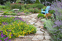 63821-19405 Flower garden with stone path, blue chair, birdbath. Homestead Purple Verbena, yellow lantana, Russian Sage, Gomphrena IL