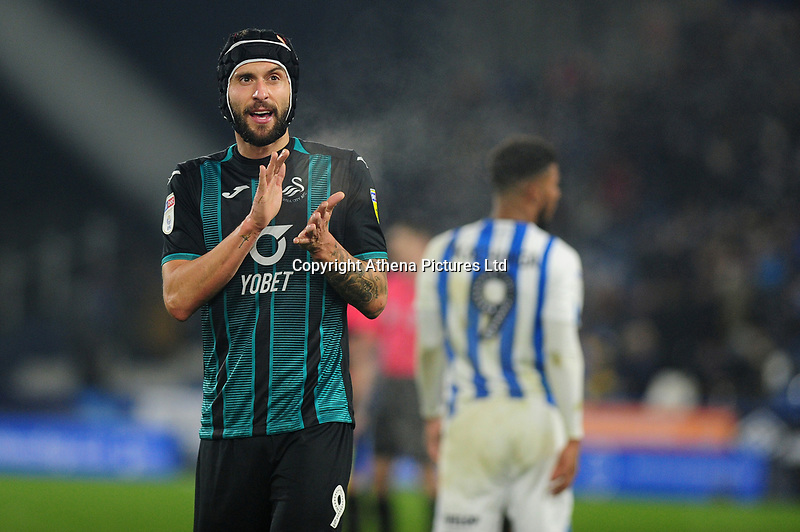 Borja Baston of Swansea City applauds the fans at the final whistle during the Sky Bet Championship match between Huddersfield Town and Swansea City at The John Smith's Stadium in Huddersfield, England, UK. Tuesday 26 November 2019