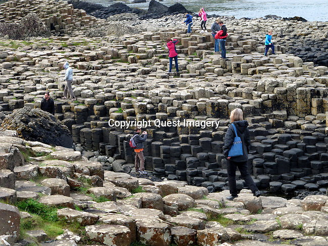 The Giant's Causeway is an area of about 40,000 interlocking basalt columns, the result of an ancient volcanic eruption. It is located in County Antrim on the northeast coast of Northern Ireland, about three miles northeast of the town of Bushmills.<br />