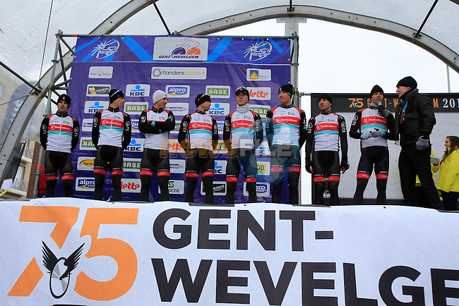 Radioshack Leopard Trek team riders on the podium with temperatures at -3 and wind chill of -16 at the sign on before the 75th edition of Gent-Wevelgem in Deinze, Belgium, 24th  March 2013 (Photo by Eoin Clarke 2013)