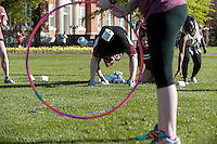 E-Week: Amazing Race Engineering student throws toilet paper through hula hoop.<br />  (photo by Robert Lewis / &copy; Mississippi State University)