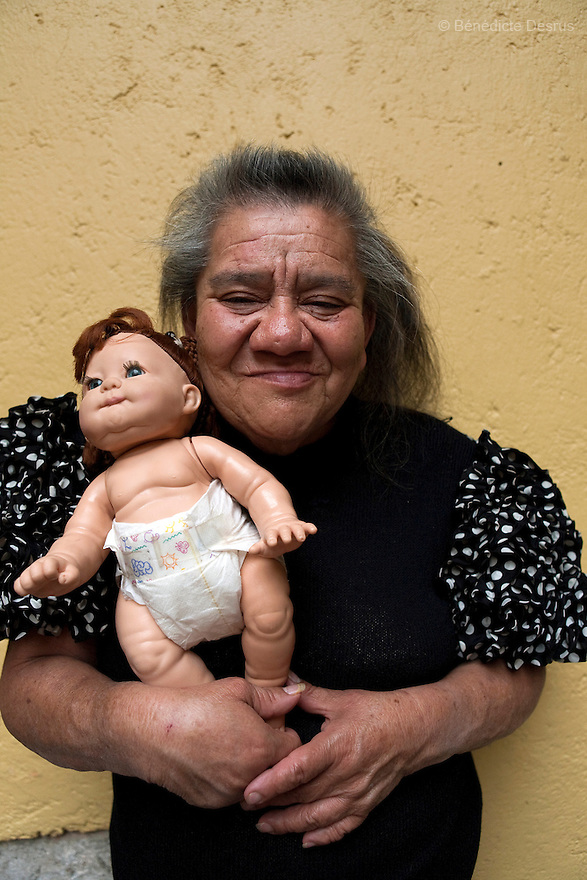 Canela, a resident of Casa Xochiquetzal, portrayed wih her doll at the shelter in Mexico City, Mexico on July 29, 2008. Casa Xochiquetzal is a shelter for elderly sex workers in Mexico City. It gives the women refuge, food, health services, a space to learn about their human rights and courses to help them rediscover their self-confidence and deal with traumatic aspects of their lives. Casa Xochiquetzal provides a space to age with dignity for a group of vulnerable women who are often invisible to society at large. It is the only such shelter existing in Latin America. Photo by Bénédicte Desrus