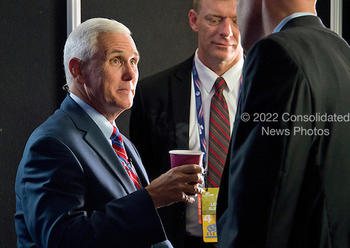 Governor Mike Pence (Republican of Indiana) speaks to aides as he sits for a series of interviews prior to the start of the last session of the 2016 Republican National Convention held at the Quicken Loans Arena in Cleveland, Ohio on Thursday, July 21, 2016.<br /> Credit: Ron Sachs / CNP<br /> (RESTRICTION: NO New York or New Jersey Newspapers or newspapers within a 75 mile radius of New York City)