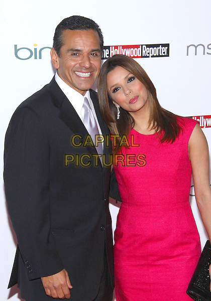 ANTONIO VILLARAIGOSA, Mayor of Los Angeles & EVA LONGORIA PARKER .The Hollywood  Reporter Honoring Oscar Nominees  held at The Getty House,  Los Angeles, California, USA, 5th March 2010..half length pink dress sleeveless navy blue suit tie smiling black clutch bag  .CAP/ADM/TC.©T. Conrad/AdMedia/Capital Pictures.