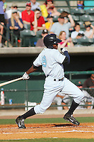 Charleston RiverDogs outfielder Mikeson Oliberto #19 at bat during a game against the Augusta GreenJackets  at Joseph P. Riley Jr. Ballpark  on April 13, 2014 in Charleston, South Carolina. Augusta defeated Charleston 2-1. (Robert Gurganus/Four Seam Images)
