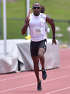 Fairfax, VA - July 3, 2015: Dave Smith of the USA Police team wins the Men's 4x100 relay in the 18-29 age group during the World Police and Fire Games, July 3, 2015, on the campus of George Mason University in Fairfax, VA. In addition to Smith, the team consisted of Kwame Domfe, Brent Gray and Elijah Simpson Team USA Police won with a time of 42.68.   (Photo by Don Baxter/Media Images International)