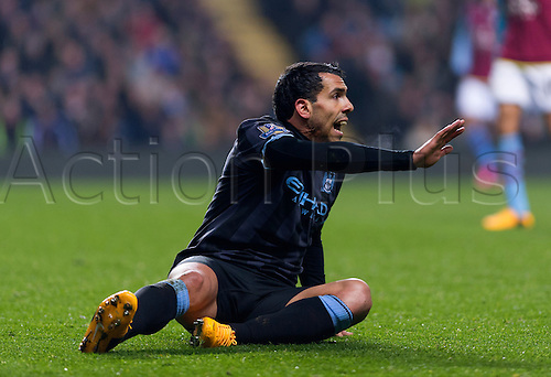 04.03.2013 Birmingham, England. Manchester City's Carlos Tévez brought down during the Premier League game between Aston Villa and Manchester City from Villa Park.
