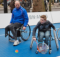08-02-14, Netherlands,RotterdamAhoy, ABNAMROWTT,, Streettennis in wheelchairs in the center of Rotterdam with Ronald Vink (NED)  <br /> Photo:Tennisimages/Henk Koster