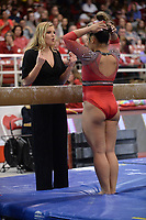 Arkansas interim assistant coach Catelyn Orel speaks Friday, Feb. 7, 2020, with Jessica Yamzon during the Razorbacks' meet with Georgia in Barnhill Arena in Fayetteville. Visit  nwaonline.com/gymbacks/ for a gallery from the meet.<br /> (NWA Democrat-Gazette/Andy Shupe)