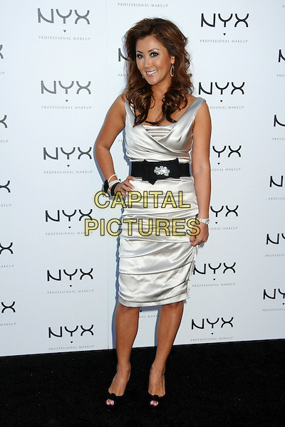 "TONI KO, CEO of Nyx Cosmetics.Nyx Cosmetics ""Decade+1 Unveiled"" Event held at the Roosevelt Hotel, Hollywood, California, USA,.18th May 2010. .full length silver grey gray silk satin ruched dress sleeveless  black waist belt bow hand on hip peep toe shoes .CAP/ADM/BP.©Byron Purvis/AdMedia/Capital Pictures."