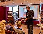 July 26, 2017. Raleigh, North Carolina.<br /> <br /> Alan Gratz discusses his new book &quot;Refugee&quot; with early arrivers to the signing event. <br /> <br /> Author Alan Gratz spoke about and signed his new book &quot;Refugee&quot; at Quail Ridge Books. The young adult fiction novel contrasts the stories of three refugees from different time periods, a Jewish boy in 1930's Germany , a Cuban girl in 1994 and a Syrian boy in 2015.
