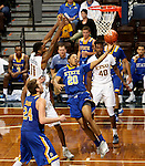 SIOUX FALLS, SD - NOVEMBER 26:  Andre Wallace #20 from South Dakota State University takes the ball to the basket past Desonta Bradford #11 from East Tennessee State University during their game at the Sanford Pentagon Saturday evening in Sioux Falls. (Photo by Dave Eggen/Inertia)