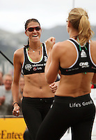 NZ's Anna Scarlett and Susan Blundell celebrate winning a point during the 2009 McEntee Hire NZ Beach Volleyball Tour - Women's final at Oriental Parade, Wellington, New Zealand on Sunday, 11 January 2009. Photo: Dave Lintott / lintottphoto.co.nz.