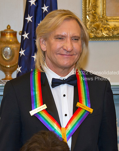 """Joe Walsh of the rock band """"The Eagles,"""" one of the five recipients of the 39th Annual Kennedy Center Honors pose for a group photo following a dinner hosted by United States Secretary of State John F. Kerry in their honor at the U.S. Department of State in Washington, D.C. on Saturday, December 3, 2016.  The 2016 honorees are: Argentine pianist Martha Argerich; rock band the Eagles; screen and stage actor Al Pacino; gospel and blues singer Mavis Staples; and musician James Taylor.<br /> Credit: Ron Sachs / Pool via CNP"""