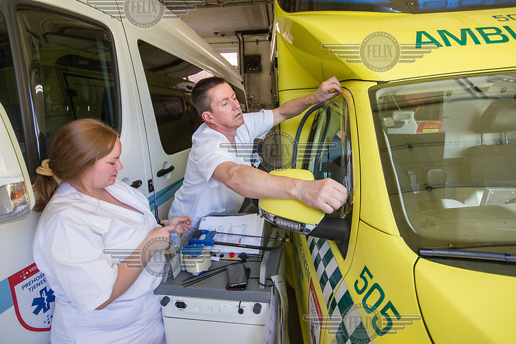 An ambulance being sealed up during a decontamination process during the Covid-19 , coronaviraus, pandemic.<br /> <br /> <br /> ©Fredrik Naumann/Felix Features