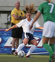 Action photo of Christie Rampone of United States celebrating the championship, during game of the Womens Preolympic soccer tournament held at Ciudad Juarez. Mexico.
