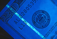 OPTICAL SECURITY FEATURES ON U.S. CURRENCY<br /> Fluorescent Security Strip On Twenty Dollar Bill.Under UV light, the thread glows green.  Luminescence caused by the absorption of radiant energy (such as ultraviolet light) and ceases as soon as the radiation causing it ceases is known as fluorescence.