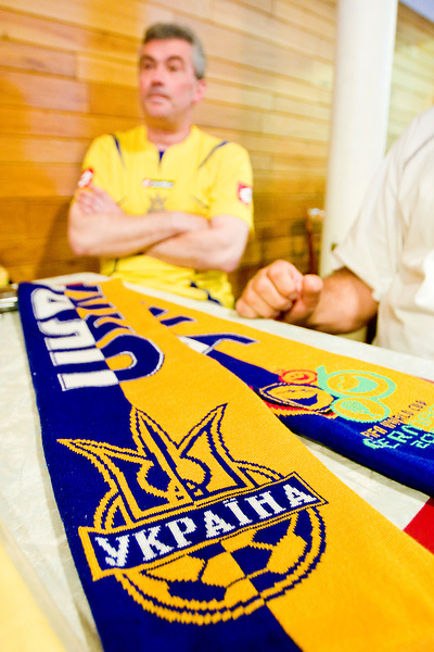 Ukraine fans watch their team play a World Cup match against Saudi Arabia on June 19, 2006 at the Ukrainian Sports Club in New York City.<br /> <br /> The World Cup, held every four years in different locales, is the world's pre-eminent sports tournament in the world's most popular sport, soccer (or football, as most of the world calls it).  Qualification for the World Cup is open to any country with a national team accredited by FIFA, world soccer's governing body. The first World Cup, organized by FIFA in response to the popularity of the first Olympic Games' soccer tournaments, was held in 1930 in Uruguay and was participated in by 13 nations.    <br /> <br /> As of 2010 there are 208 such teams.  The final field of the World Cup is narrowed down to 32 national teams in the three years preceding the tournament, with each region of the world allotted a specific number of spots.  <br /> <br /> The World Cup is the most widely regularly watched event in the world, with soccer teams being a source of national pride.  In most nations, the whole country is at a standstill when their team is playing in the tournament, everyone's eyes glued to their televisions or their ears to the radio, to see if their team will prevail.  While the United States in general is a conspicuous exception to the grip of World Cup fever there is one city that is a rather large exception to that rule.  In New York City, the most diverse city in a nation of immigrants, the melting pot that is America is on full display as fans of all nations gather in all possible venues to watch their teams and celebrate where they have come from.