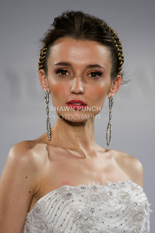 "Model walks runway in a Dubai wedding dress from the Yumi Katsura Fall 2013 ""Painting The World With Beauty"" bridal collection, during The Couture Show New York Bridal Fashion Week, October 14, 2012."