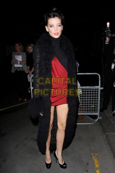 DAISY LOWE .The Vogue Dinner Party at La Caprice Restaurant, London, England..September 21st, 2009.full length black red coat dress mini long fur .CAP/AH.©Adam Houghton/Capital Pictures.
