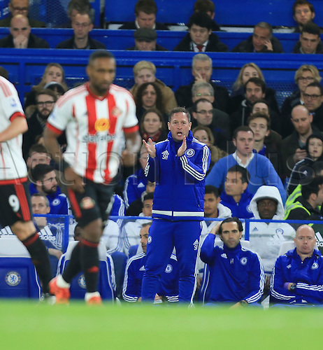 19.12.2015. Stamford Bridge, London, England. Barclays Premier League. Chelsea versus Sunderland. Steve Holland applauds his sides third goal.