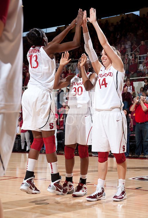 STANFORD, CA - January 22, 2011: Chiney Ogwumike, Nnemkadi Ogwumike and Kayla Pedersen of the Stanford women's basketball team before their game against USC at Maples Pavilion. Stanford beat USC 95-51.