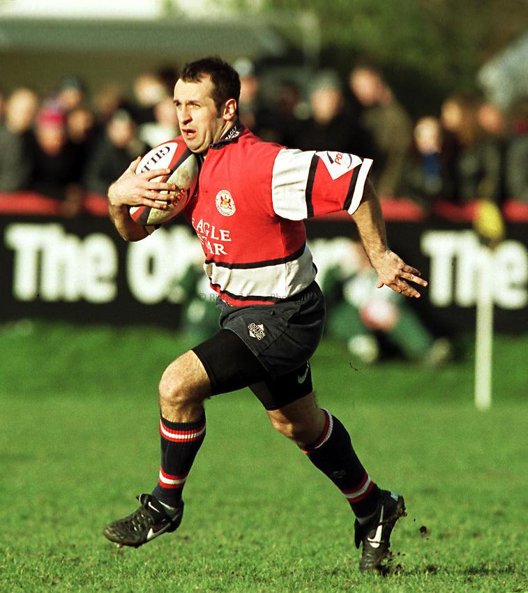 Photo. Richard Lane.. London Irish v Gloucester.7/2/99..Philippe Saint-Andre attacks for Gloucester.