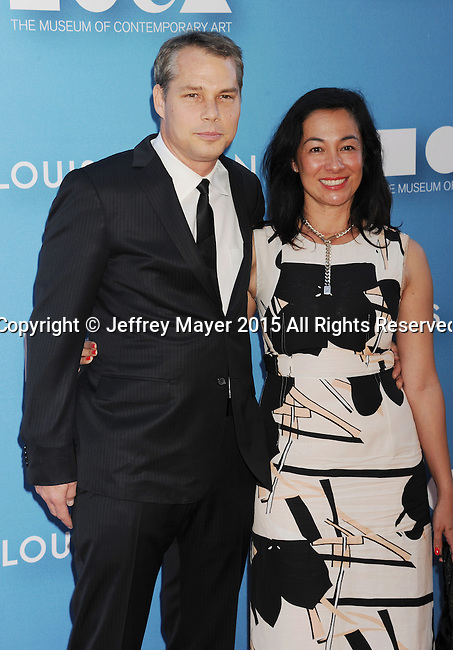 LOS ANGELES, CA - MAY 30: Artist Shepard Fairey (L) and wife Amanda Fairey arrive at the 2015 MOCA Gala presented by Louis Vuitton at The Geffen Contemporary at MOCA on May 30, 2015 in Los Angeles, California.