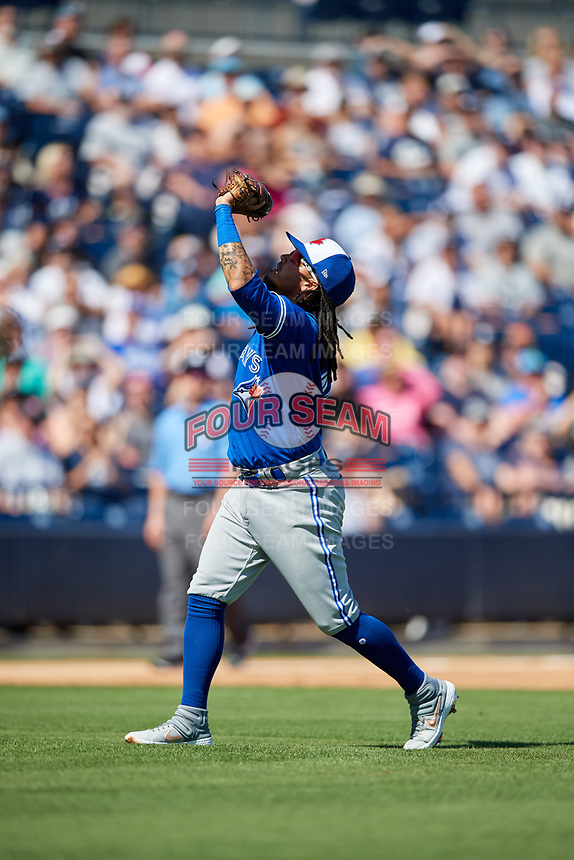 Toronto Blue Jays shortstop Freddy Galvis (16) settles under a pop up during a Grapefruit League Spring Training game against the New York Yankees on February 25, 2019 at George M. Steinbrenner Field in Tampa, Florida.  Yankees defeated the Blue Jays 3-0.  (Mike Janes/Four Seam Images)