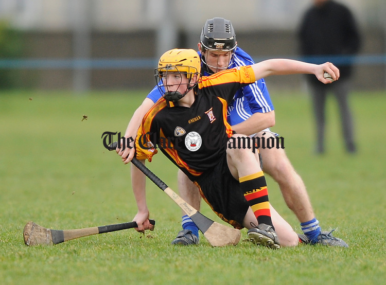 Shane Dowling of Ard Scoil Ris  is tackled by Raymond Mc Namara of St Flannan's during their Harty Cup quarter final at LIT. Photograph by John Kelly.