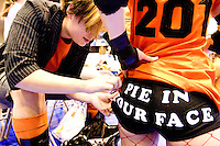 Roxy Balboa sews up a piece of Sweet Sherry Pie's uniform before the start of the Manhattan Mayhem's match against the Bronx Gridlock at a Gotham Girls Roller Derby bout in New York City on May 6, 2006.