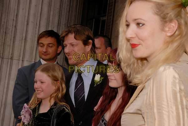 SEAN BEAN & GEORGINA SUTCLIFFE.Outside Marylebone Registry Office after their marriage ceremony, London, England, February 19th 2008..Wedding married getting hitched couple husband wife fourth time 4th half length bride groom confetti register guests family.CAP/IA.?Ian Allis/Capital Pictures