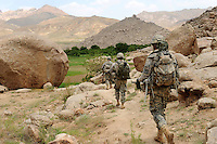 Bravo Company,1-4 Infantry, on recon patrol in the mountains near FOB Baylough in remote, central Zabul Province, Afghanistan, June 18, 2009. The terrain is so rough here that almost all patrols are dismounted - that means no lifts from a Humvee, carrying all their gear through the mountains.