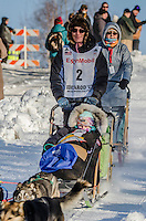 Ryan Redington and team run past spectators and down the Cordova Street hill with an Iditarider in the basket and a handler during the Anchorage, Alaska ceremonial start on Saturday March 4th during the 2017 Iditarod race. Photo ©2017 by Daniel Lent/SchultzPhoto.com