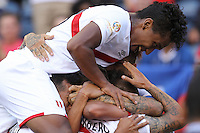 Seattle, WA - Saturday June 04, 2016: Peru forward Paolo Guerrero (9)  celebrates scoring with teammates during a Copa America Centenario Group B match between Haiti (HAI) and Peru (PER) at Century Link Field.