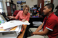 NWA Democrat-Gazette/ANDY SHUPE<br /> Instructor Jeanie Nance (left) helps Juan Zacharias, 17, Thursday, April 13, 2017, with translating a paragraph into English in the language academy meant for English language learners at Har-Ber High School in Springdale. A new law, Act 991, changes testing and performance requirements for English language learners in the state's academic accountability system.