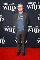 HOLLYWOOD, CA - FEBRUARY 13; John Powell at The Call Of The Wild World Premiere on February 13, 2020 at El Capitan Theater in Hollywood, California. Credit: Tony Forte/MediaPunch